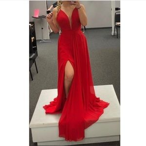 Red prom dress with a lace up back and slit